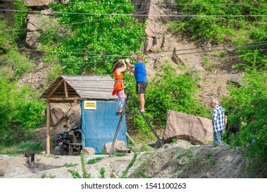 Migeya, Ukraine - 05.13.2019. Active rest and adventures on the Radon Lake in a place of flooded granite quarry near the Southern Bug river in Mygiya village, Ukraine