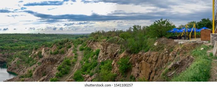 Migeya, Ukraine - 05.13.2019.  Radon Lake in a place of flooded granite quarry near the Southern Bug river in Mygiya village, Ukraine