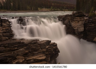 The mighty Athabasca Waterfall in Banff National Park, Canada, the torrent of water squeezes through a gap in rocks and falls many feet, long exposure to create blurred motion to the waterfall
