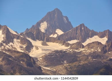 the mighty Finsteraarhorn in the Bernese Alps viewed from the South in Switzerland