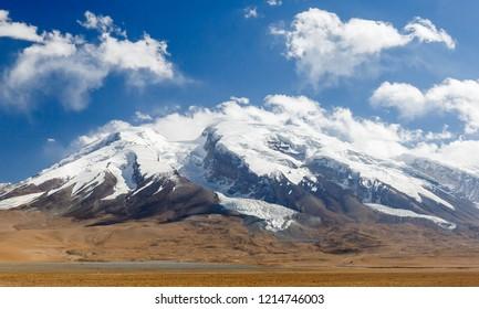 Mighty Muztagata Mountain (Xinjiang, China) - also called Mustagh Ata, Mouztagh-ata or Muz Tagh Ata. - Shutterstock ID 1214746003