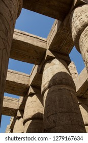 The mighty pillars or columns of the ancient temple complex of the opern air museum in Karnak in Luxor, Egypt