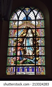 MIGNAULT, BELGIUM-AUGUST 22, 2014: Stained glass window in Saint-Martin Church