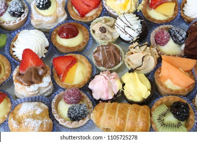 mignon pastries filled with creams and fruits for sale in a pastry shop