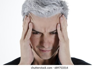 Migraine. Stress and problems. An attractive guy with gray hair.