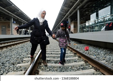 Migrant families sit on the train station platform and stand on the rails to block the line during a protest at Larissis railway central station in Athens, Greece on April 5, 2019.