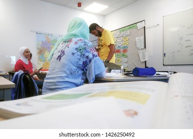 Migrants from Africa, Asia and the Middle East learn German in the class of the international school Inlingua in Halle (Saale), Germany, 29.052018