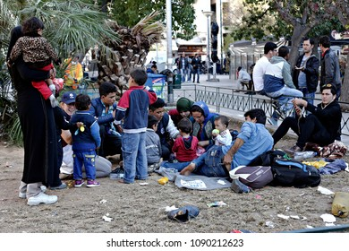 Migrants sit on November 13, 2015 at the Victoria square in central Athens, where hundreds of migrants and refugees stay temporarily.