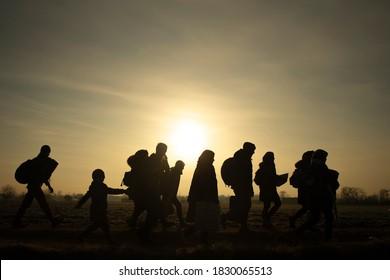 Migrants walk towards the Turkey's Pazarkule border crossing with Greece's Kastanies, in Edirne, Turkey March 1, 2020.