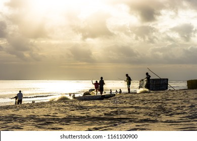São Miguel do Gostoso, Rio Grande do Norte/Brazil - 06-21-2018: Silhouette of fishermen doing artisanal fishing early morning