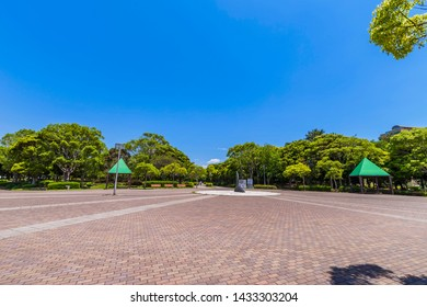 """MIHAMA, CHIBA / JAPAN - MAY 30 2019 : Landscape of """"Makuhari Seaside Park"""". It is a vast park surrounded by trees."""