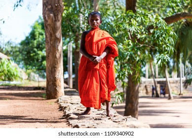 Mihintale, Sri lanka - August 16, 2017: A novice buddhist monk looking at camera in the sacred site of Mihintale, now a pilgrimage site