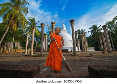 Mihintale, Sri Lanka, August-30-2017 Buddhist novice boy sweeping part of the Mihintale temple
