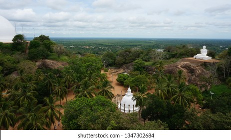 Mihintale, Sri Lanka Big white Buddha statue against blue sky in Mihintale, the cradle of buddhism at Sri Lanka