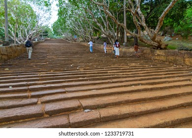 Mihintale - Sri lanka - Circa 2013 - Pilgrims make their way to and from the ancient site, believed to be the birthplace of Buddhism in Sri Lanka, to offer alms to the Buddha.