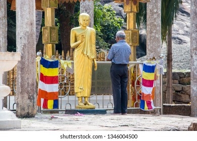 Mihintale (Sri Lanka), February 25, 2019. Man praying in the Buddhist temple of the sacred hill of Mihintale in Sri Lanka.