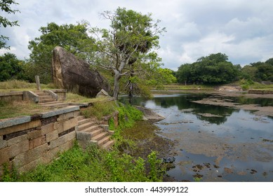 MIHINTALE, SRI LANKA - MARCH 12, 2015: The ruins of the ancient Buddhist monastery Rajagiri Kanda near a Pond of Black Water