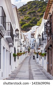 Mijas , Malaga / Spain - October 07 2018 : Typically alee street in famous village Mijas , with white house and isolated bars. Malaga Spain