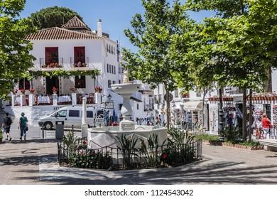MIJAS, SPAIN - JUNE 1, 2018: View of Constitution Square (Plaza de la Constitucion) in picturesque White Mountain village of Mijas. Costa del Sol, Malaga province, Andalusia.