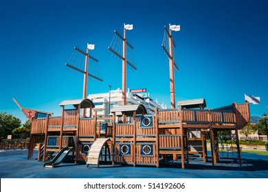 MIJAS, SPAIN - JUNE 19, 2015: Child playground shaped old wooden pirate ship in park