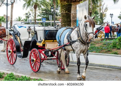 Mijas, Spain - March 16, 2017: Horse carriage waiting for tourist in picturesque white village of Mijas. Costa del Sol. Southern Spain