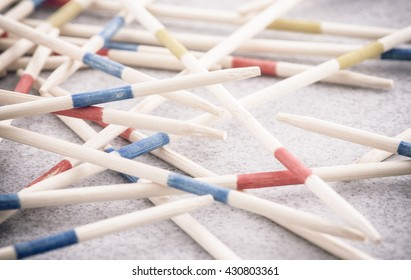 Mikado game wooden sticks on table. Concept of Fun game with strategy, a real mess or chaos.