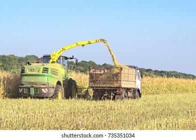 Mikhailovka, Ukraine - August 25: Self-Propelled Forage Harvester John Deere 8300 and truck. Harvesting and processing in forage near the village Mikhailovka, Central Ukraine August 25, 2017