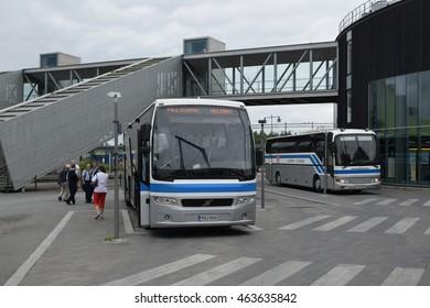 Mikkeli, Finland - July 23, 2016. Intercity coaches of the Kuopion Liikenne agency at the platforms of the passenger transit center of Mikkeli
