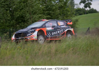 MIKOLAJKI, POLAND - JUL 1: Mads Ostberg and his codriver Ola Floene in Ford Fiesta WRC race in the 74nd Rally Poland, on July 1, 2017 in Mikolajki, Poland.