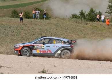 MIKOLAJKI, POLAND - JUL 2: Thierry Neuville and his codriver Nicolas Gilsoul in a Hyundai New Generation i20 WRC race in the 73nd Rally Poland, on July 2, 2016 in Mikolajki, Poland.