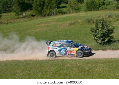 MIKOLAJKI, POLAND - JUL 3: Andreas Mikkelsen and his codriver Ola Floene in a Volkswagen Polo R WRC race in the 72nd Rally Poland, on July 3, 2015 in Mikolajki, Poland.