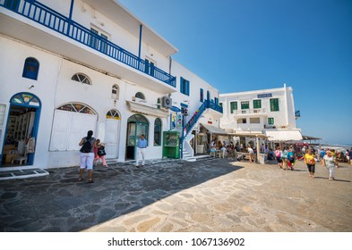 Mikonos, Greece - August 21, 2013: tourist visiting typical street in mikonos island, Greece.