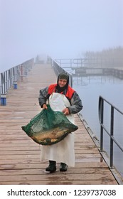 MIKRI PRESPA LAKE, FLORINA, MACEDONIA, GREECE- January 13, 20014. Fisherman on the the footbridge that leads to Agios Achilleios islet.