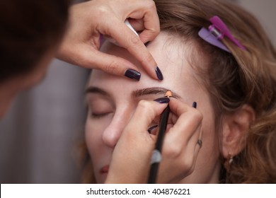 Mikrobleyding eyebrows workflow in a beauty salon. Selective focus and shallow Depth of field.