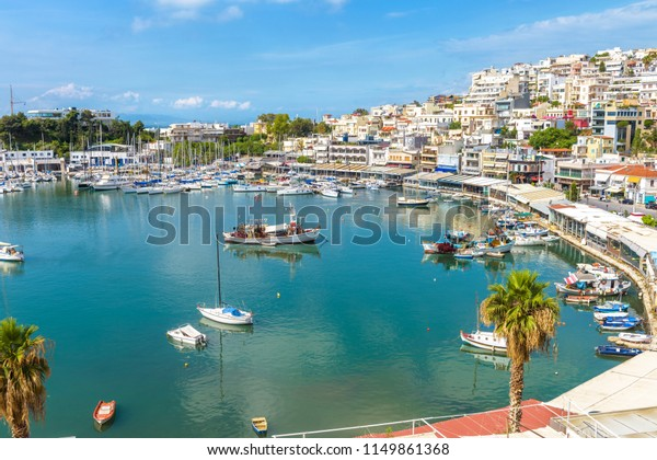 Mikrolimano marina in Piraeus, Athens, Greece. Panoramic view of the beautiful harbor with sail boats. Scenery of the city coast with scenic sea port. Luxury marine relax on the waterfront of Athens.