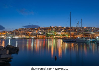 Mikrolimano and view of Kastella hill in Greece during blue hour