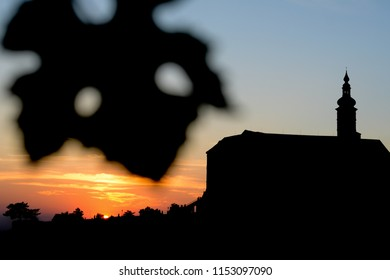 Mikulov castle / clock tower silhouette at the sunset with nice blue smooth sky , Mikulov south Moravia , Czech republic , summer autumn spring touristic destination, wine culture city