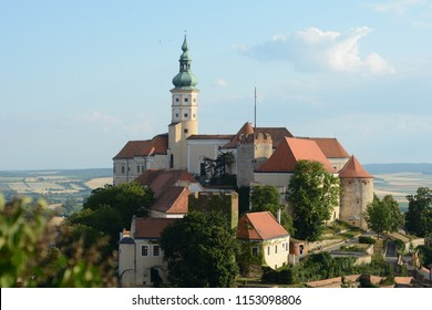 Mikulov castle / clock tower at the sunrise with nice blue smooth sky , Mikulov south Moravia , Czech republic , summer autumn spring touristic destination