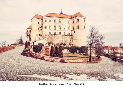 Mikulov castle, southern Moravia, Czech republic. Travel destination. Architectural scene. Red photo filter.