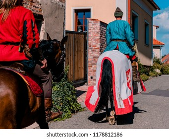 MIKULOV, CZECH REPUBLIC - SEPTEMBER 9, 2018: Picture of actors showing old medival ride on the horses on the streets in the centre of Mikulov.