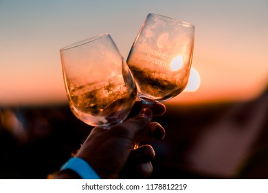 MIKULOV, CZECH REPUBLIC - SEPTEMBER 9, 2018: Picture of two wine glasses from Mikulov grape harvest at sunset.