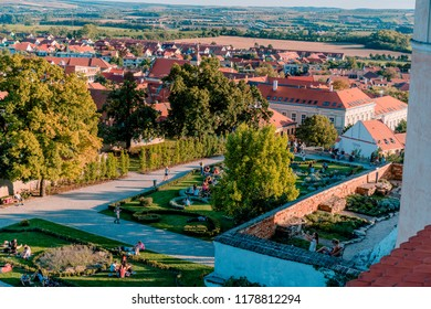 MIKULOV, CZECH REPUBLIC - SEPTEMBER 9, 2018: Pictures of visitors lying in the park and drinking wine at grapes harvest festival in Mikulov.
