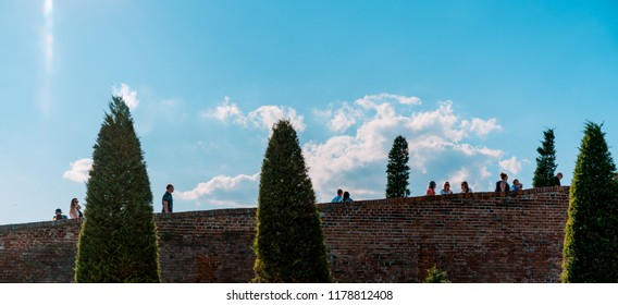 MIKULOV, CZECH REPUBLIC - SEPTEMBER 9, 2018: Picture of people walking straight to the castle of Mikulov.