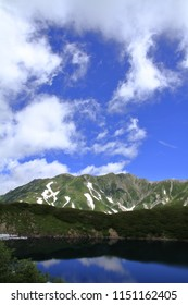 Mikurigaike pond and Tateyama mountain range with snow in summer in Toyama, Japan