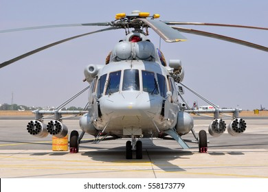 A Mil Mi-17 with rocket launcher pods parked on the tarmac at the Aero India Show.