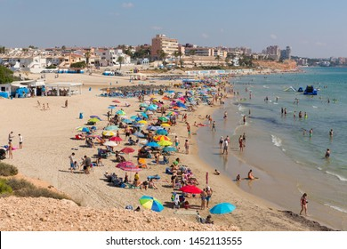 MIL PALMERAS, SPAIN-JULY 3rd 2019: Beautiful weather attracted holidaymakers to the popular Playa de la Mil Palmeras beach on the Costa Costa Blanca, Mil Palmeras, Spain on Wednesday 3rd July 2019