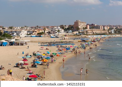 MIL PALMERAS, SPAIN-JULY 3rd 2019: The beautiful beach and fine weather attracted holidaymakers to the Costa Blanca at Mil Palmeras, Spain on Wednesday 3rd July 2019