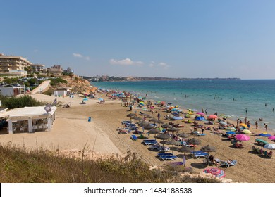 MIL PALMERAS, SPAIN-JULY 3rd 2019: Beautiful weather attracted holidaymakers to Playa Vistamar beach, Mil Palmeras, Spain on Wednesday 3rd July 2019