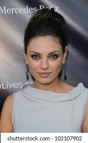 Mila Kunis  at the 9th Annual Chrysalis Butterfly Ball, Private Location, Beverly Hills, CA. 06-05-10