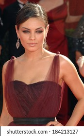 Mila Kunis , wearing a Monique Lhuillier dress and Fred Leighton jewelry, at 61st Primetime Emmy Awards ,Nokia Theatre, Los Angeles, CA September 20, 2009 Photo By Dee Cercone/Everett Collection